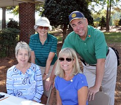 Daughters of Jack Andrews: L-R: Janet Johnson and Jackie Gooch. In rear are Rotarian Linda Brooks chair of the tournament with Club President Scott Tarkenton.