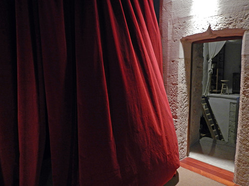 A billowing red velvet curtain hides a mystery in Cuellar Castle in Spain