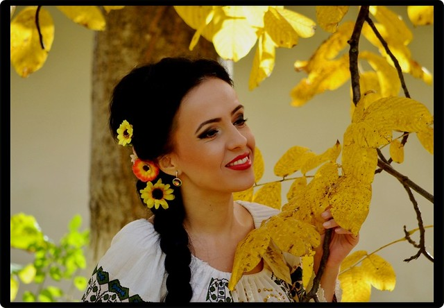 Romanian autumn: Woman in national costume