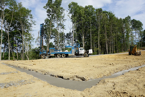 Footers are poured and the well is drilled