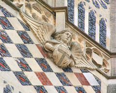 Instruments of the Passion: angel with a T cross