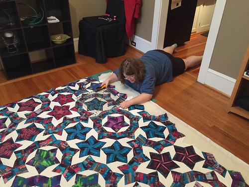 Because everyone trims the final side of a quilt they worked five years on by lying with their feet in the kitchen, right? Right?