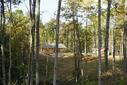 The homesite is nestled into the woods along the ridge