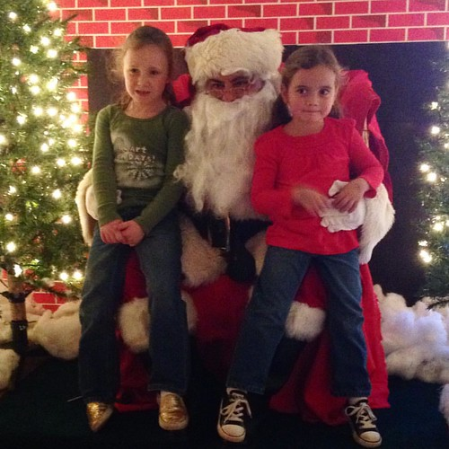 Both girls sat on Santa's lap. Again. And this time Ash almost smiled. #santa | by lisa_sff