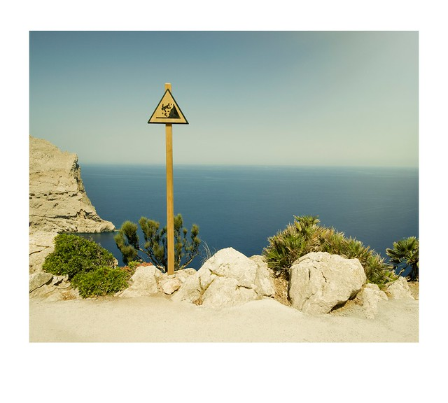 Path, safety sign drop and sea.
