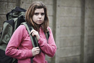 Homeless teenage girl on street with rucksack | by USDAgov
