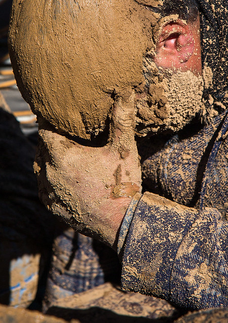 iranian shiite muslim man covered in mud crying during ashura day, Kurdistan Province, Bijar, Iran