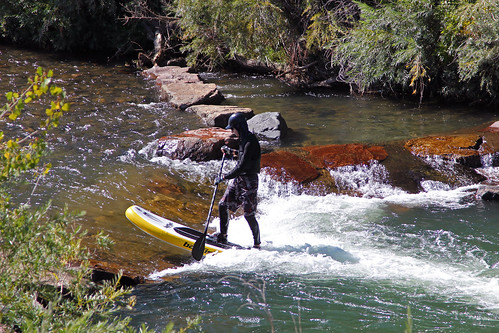 sup paddleboard standing standuppaddleboard wetsuit paddle helmet current stream clearcreek rocks goldencolorado whitewater jannagalski jannagal badfish inflatable inflated