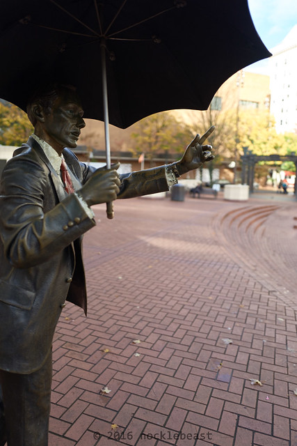 The obligatory touristy photo of that umbrella guy. Pioneer Courthouse Square. Portland, Oregon.
