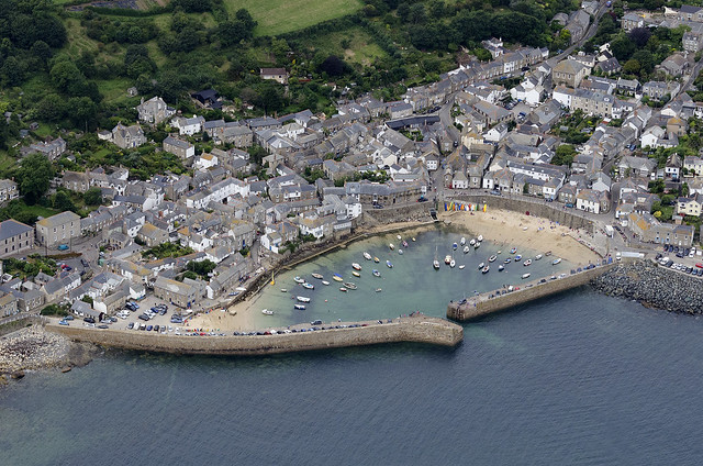 Mousehole & harbour in Cornwall - UK aerial image