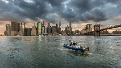 newyork brooklynbridge sunset clouds eastriver boat skyline