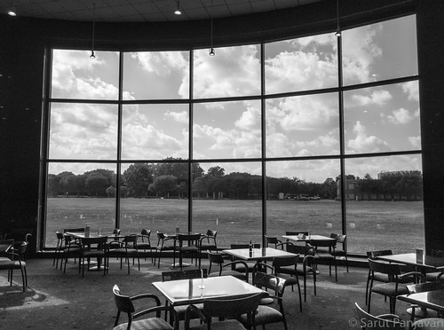 addison texas unitedstates us windows clouds tables chairs cafeteria bw iphone iphonephotography mobilephotography atchitecture architecturephotography panorama