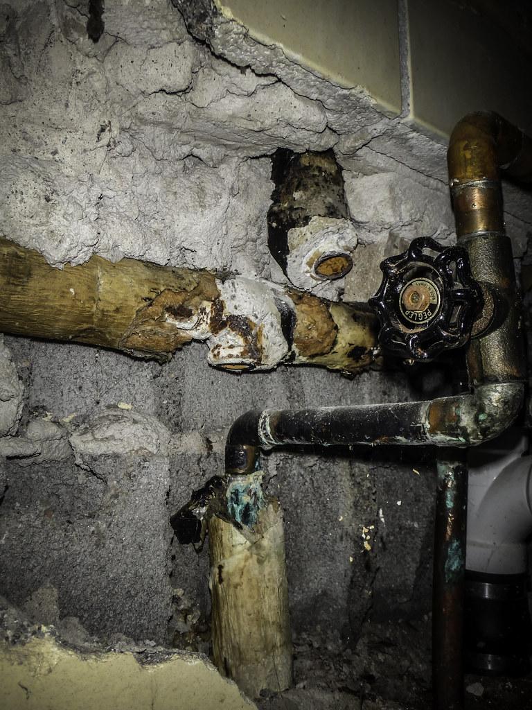 Asbestos Insulation in Wall Cavity | Damaged asbestos insula