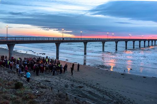 sea newzealand christchurch people beach water clouds sunrise reflections pier anniversary newbrighton september42015 quakeanniversary
