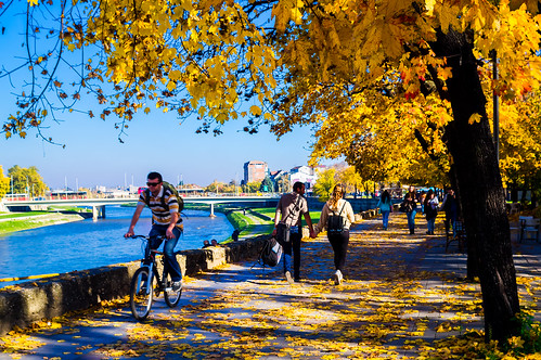 city blue autumn people green fall leaves bike bicycle yellow landscape colorful colours streetphotography m42 skopje vardar manuallenses autosears28mmf28 sonyalphaslta37 manualusers