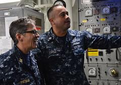 U.S. Pacific Fleet Master Chief Susan Whitman, left, speaks with Gas Turbine System Technician (Mechanical) 1st Class Avelino Lopez aboard USS Michael Murphy.  (U.S. Navy/MC2 Laurie Dexter)