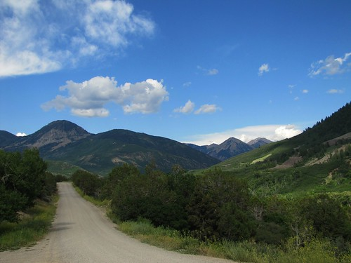 road sky mountains clouds rural colorado crawford westelkmountains