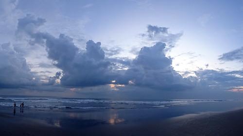 legian beach clouds symmetry sunset people silhouette