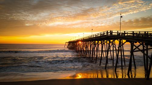 sunlight reflection beach sunrise pier waves kurebeach