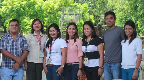 Noli Valenzuela (left) Project Dev't Officer of DSWD and his team, San Remegio Civic Center | by dilg.yolanda