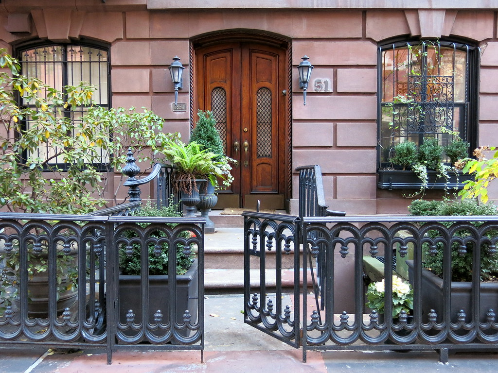 Brownstone (1854) with front garden and iron gate, West 9th Street, Greenwich Village, New York City
