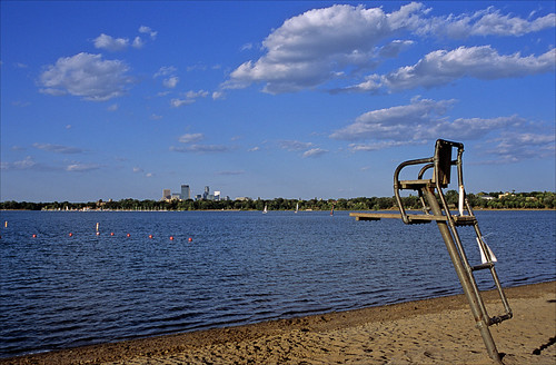 lakecalhoun clouds lifeguardchair beach shoreline bouy lake water ripples lifeguard lateafternoon trees city skyline blue chainoflakes minneapolis minnesota unitedstates usa america slidefilmthenscanned slide transparency fujichrome provia leicar6 leica r6 ronlayters