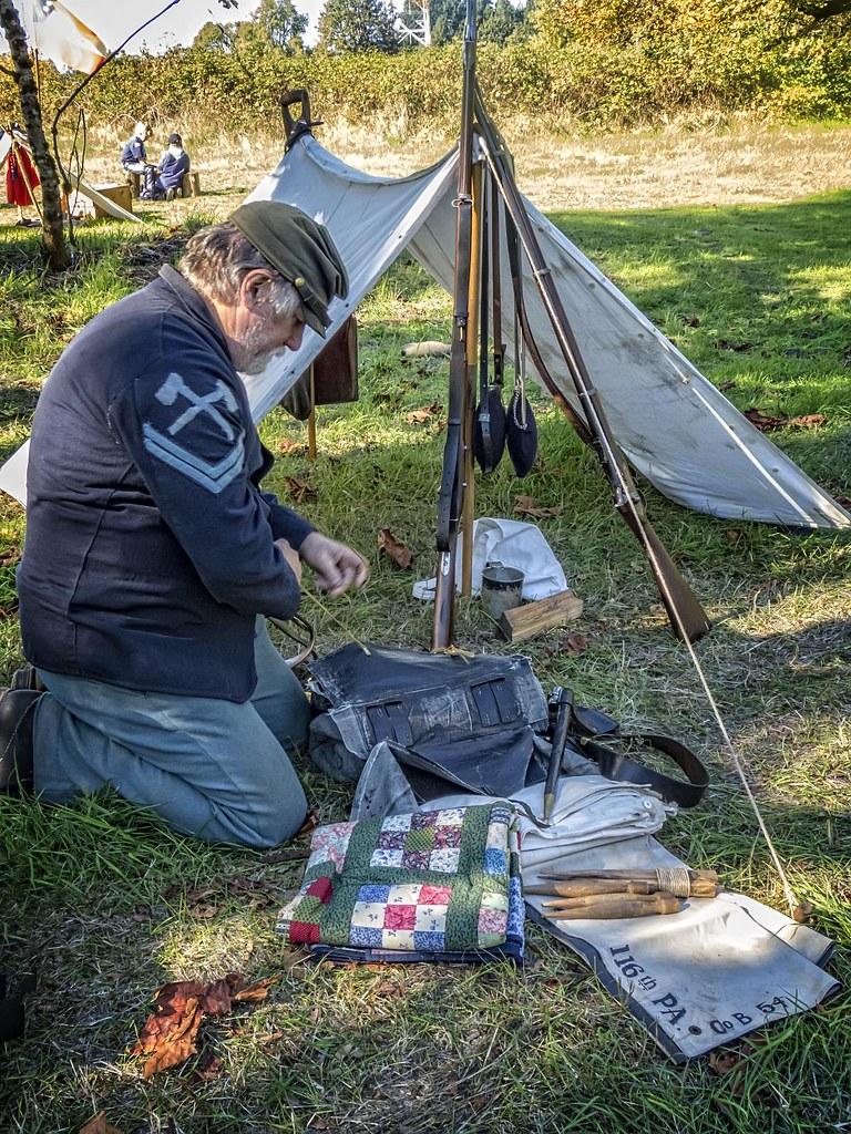An American Civil War reenactor packs his kit at a 2013 Bo