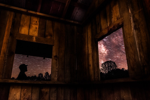 longexposure windows light shadow sky lightpainting color building tree art abandoned window nature silhouette horizontal night dark stars person one wooden experimental view creative structure westvirginia astrophotography shack derelict viewing startrails milkyway calhouncounty