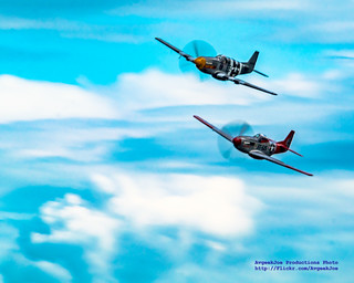 TWO P-51S ARCING IN TIGHT FORMATION