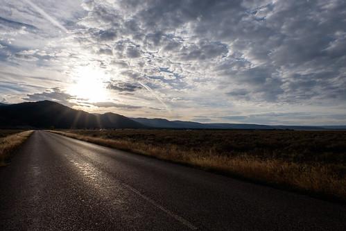 road sun clouds landscape idaho flare