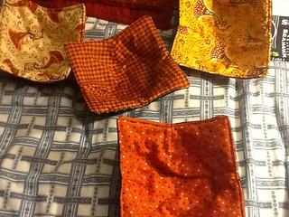 "Made 20 bowl holders using Deb Strain's ""Give Thanks"" 10 inch squares from Moda.  Perfect for these bowl holders.  Attach quilt batting on both sides, sew darts on the corners, sew both sides together wrong sides facing, turn, takes 15 minutes to make."