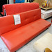 Red leatherette 2 seater sofa bed