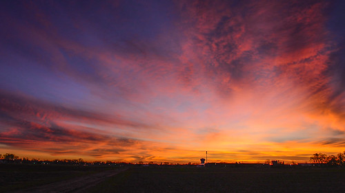 pink blue sky orange yellow clouds sunrise colorful horizon uofmcampus