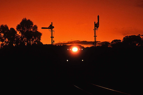 railroad sunset silhouette train diesel transport engine rail railway australia anr an transportation locomotive kodachrome signal southaustralia ambleside semaphore alco broadgauge australiannational