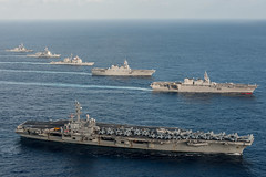 In this file photo, ships of the the Ronald Reagan Carrier Strike Group steam in formation with Japan Maritime Self-Defense Force ships during Annual Exercise in November 2015. (U.S. Navy/PO3 Nathan Burke)