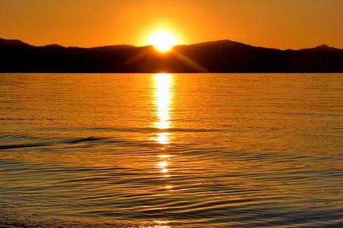 california sunset orange sun lake mountains reflection water reflections laketahoe alpine sierranevada southlaketahoe inyonationalforest waterpictorial joelach