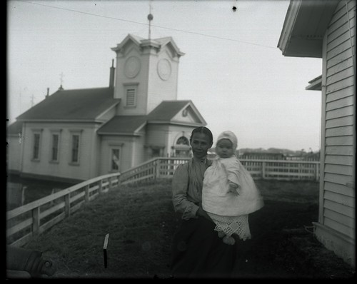 Women With Child And St Paul Church In Background | by The U.S. National Archives