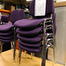 Purple fabric and chrome stacking chair