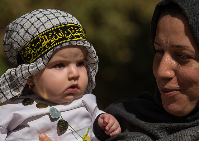 an iranian shiite mother and her child during tasua celebrations one day before ashura, Lorestan Province, Khorramabad, Iran