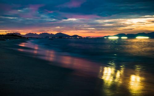 ocean city sunset sea mountains beach clouds reflections boats lights sand asia southeastasia fishermen south an east vietnam hoian citylights streaks bang hoi vn quảngnam anbang tphộian