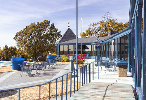 theblueheron restaurant patio deck backside pool dining cliff hill view senic scenery building lakeozark lakeoftheozarks camdencounty missouri mo beautiful stevefrazierphotography october2016mg5599 trees foliage autumn fall leaves color colorful windows