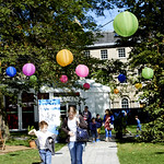 Book Festival lanterns | Families enjoying Charlotte Square Gardens in the sunshine © Helen Jones