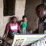 Health worker visits homes to teach families about malaria prevention and risk.