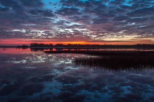 orange reflection water clouds sunrise cloudy dramatic