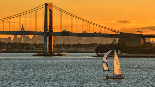 newyorkstate newyorkcity queens thebronx midtownmanhattan throgsneckbridge sailboat sunset eastriver longislandsound throgsneck kingspoint usmerchantmarineacademy empirestatebuilding skyline silhouette