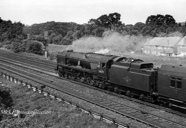 Battle of Britain Class 34071 601 SQUADRON near Raynes Park with a down express