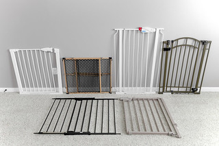 Six baby gates lined up on carpet in living room | by yourbestdigs