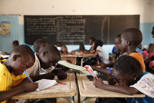 Non-disabled children work alongside a blind pupil using Braille blocks at L'Ecole Malick Diop in Dakar, Senegal.