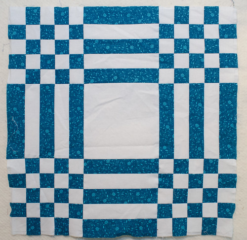 For a Carpenter's Square quilt top, you need two blocks. This is the complex block.
