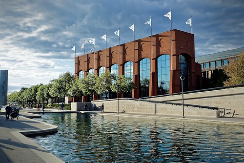 trees brick window water clouds canal exterior landscaping indianapolis flags whiteriver ncaa hallofchampions